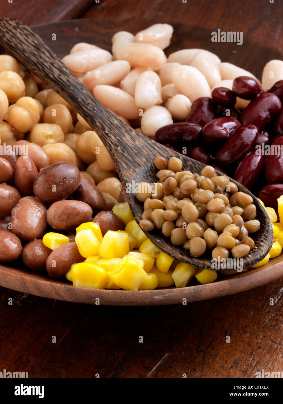 A bowl of beans red kidney lentils sweetcorn butter beans borlotti chick peas garbanzo beans - Stock Image