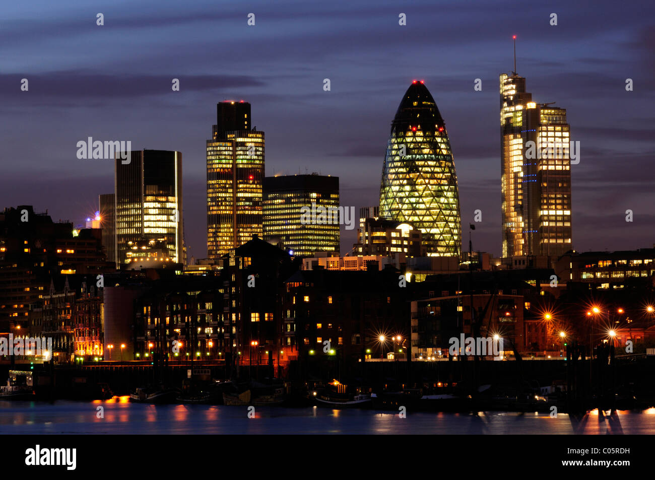 City of London Skyline at Night including Tower 42, 30 St Mary Axe and Heron Tower seen from Bermondsey, London, - Stock Image