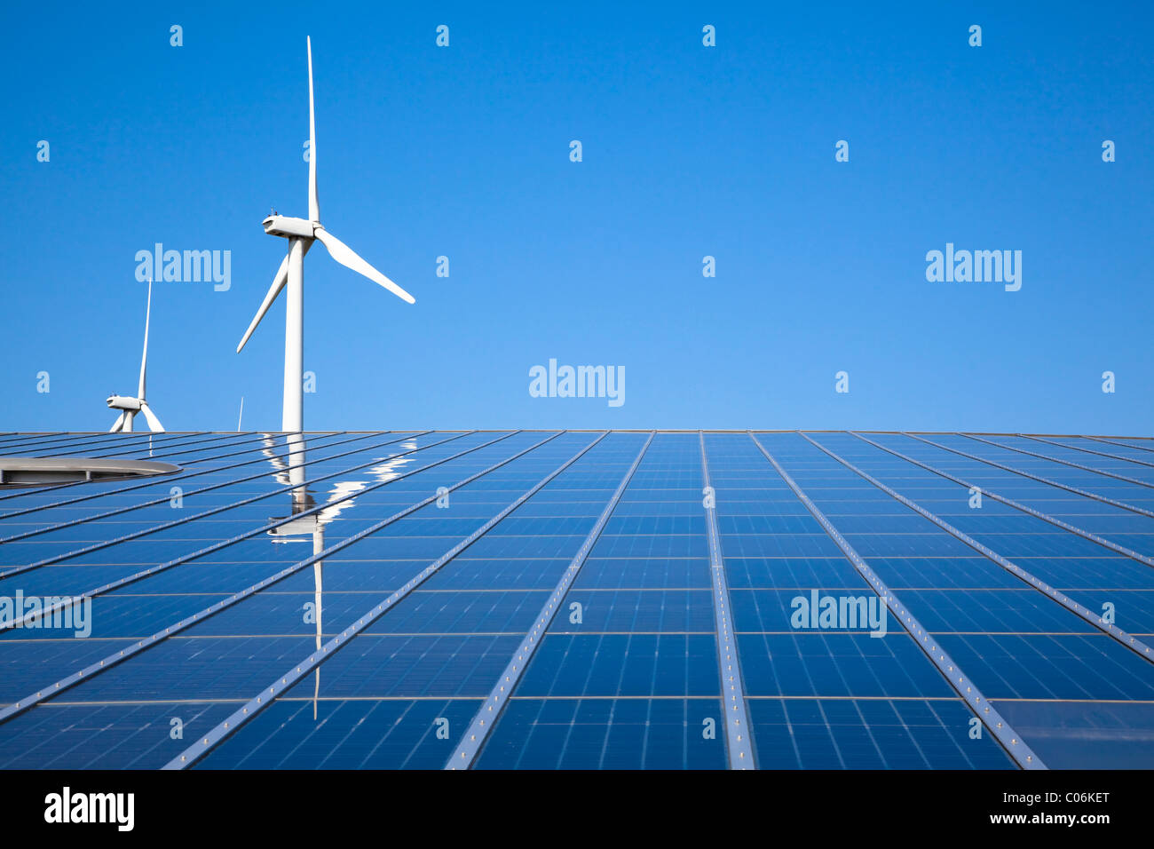 Solar and wind energy with clear sky - Stock Image