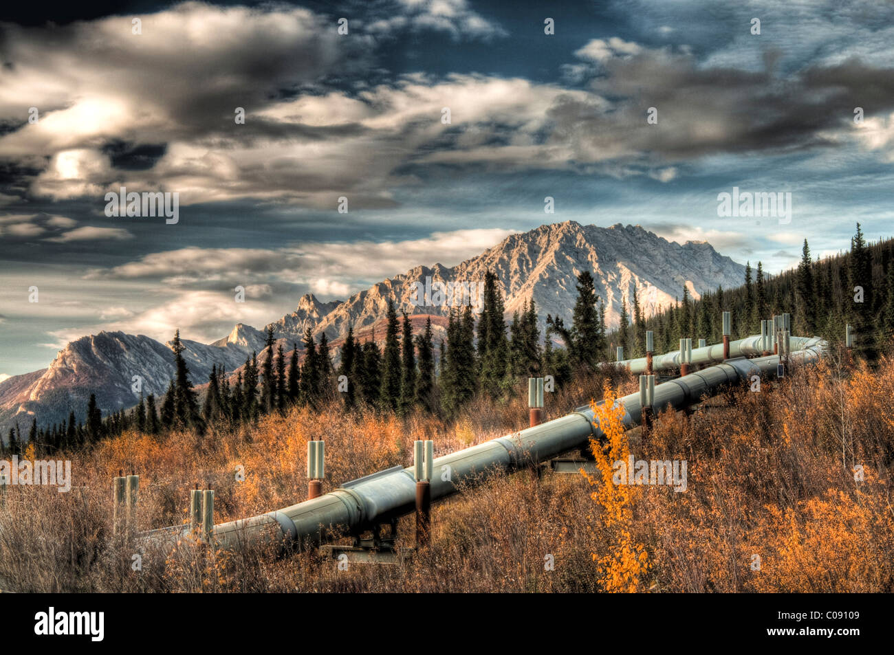 View of the Trans Alaska Pipeline winding next to Dalton Highway into the Brooks Range north of Sukapak Mountain, - Stock Image