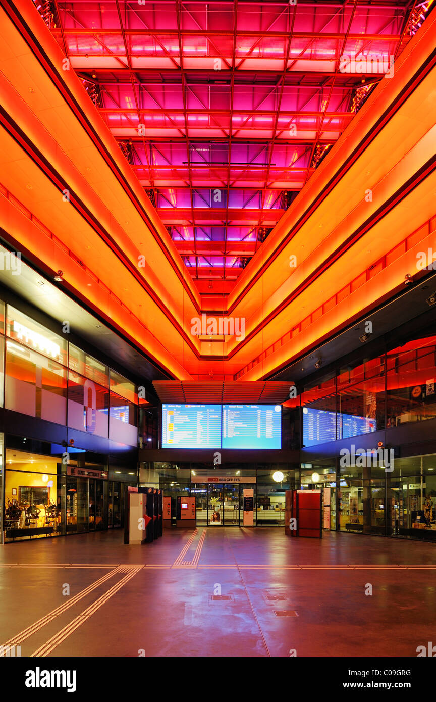 Neon-lit entrance hall of the train station in Zug, Switzerland, Europe - Stock Image