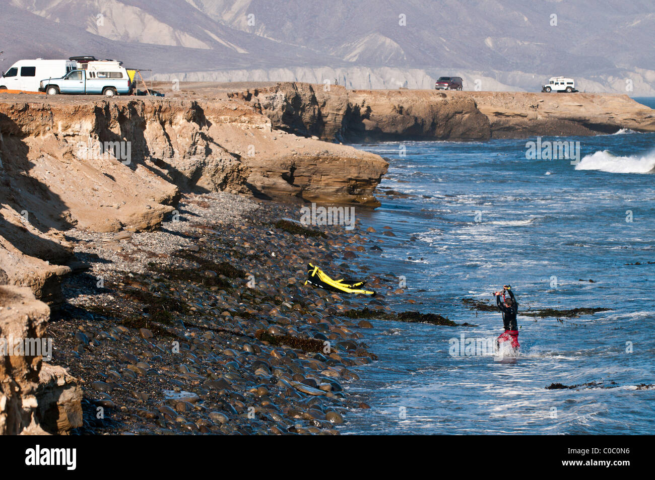 Kitesurfer & his crashed kite at Punto San Carlos, Baja California, Mexico - Stock Image