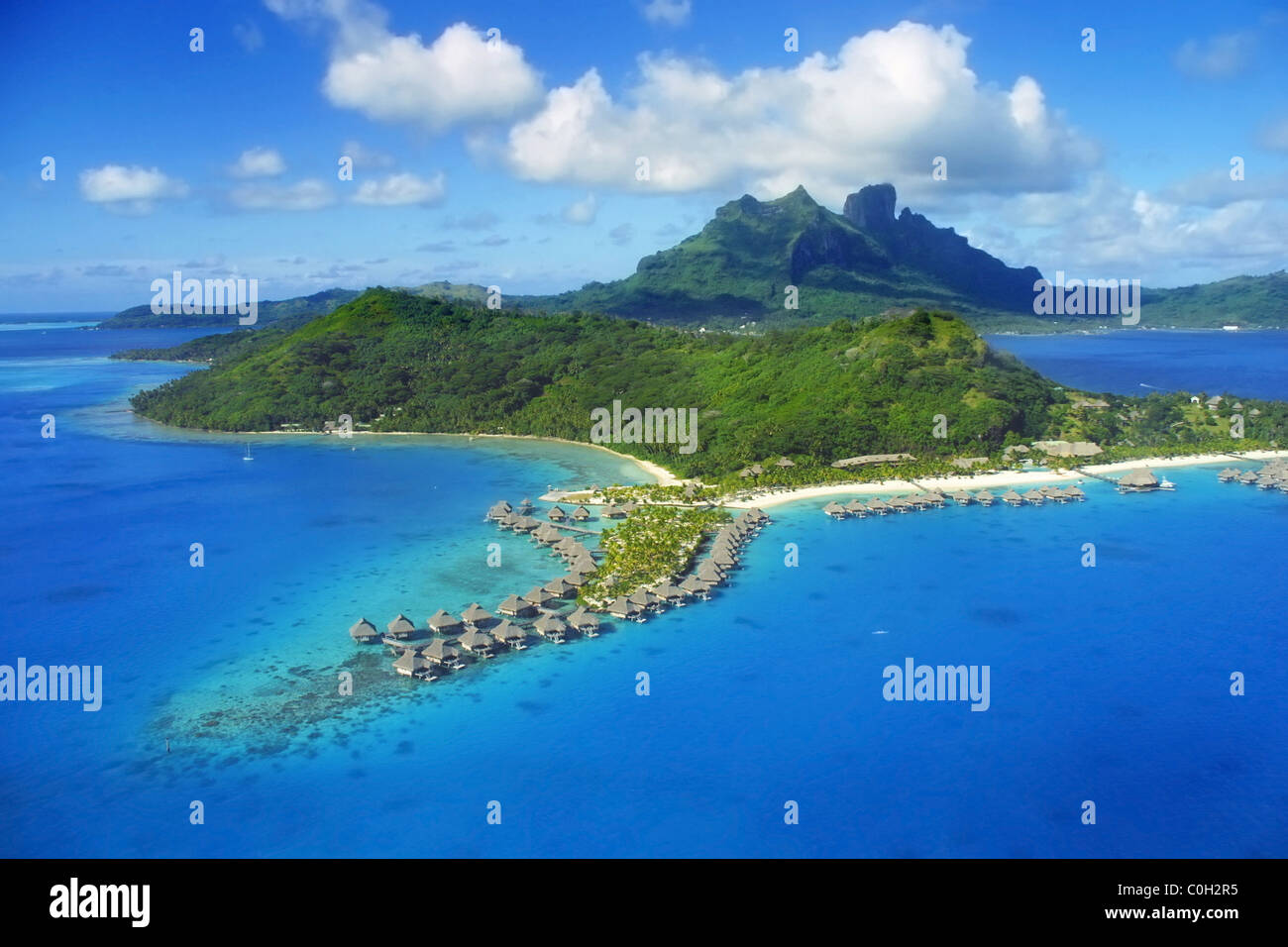 Aerial View of Bora Bora with Mount Otemanu in background and coral reef. Stock Photo