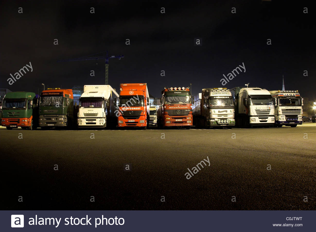 long-distance-lorry-drivers-sleeping-in-their-cabs-in-the-lorry-park-C0JTWT.jpg