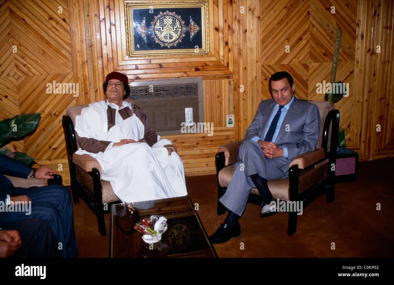 Libya President Muammar Gaddhafi meets Egyptian President Hosni Mubarak at Sidi Barani Air Base in Egypt near the - Stock Image