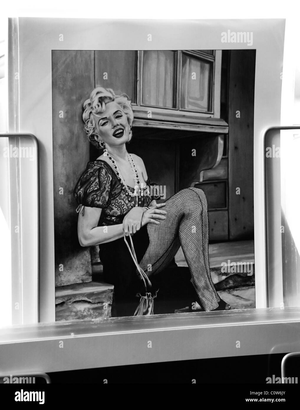 Rome, Italy, Marilyn Monroe print for sale at piazza Navona Christmas street market - Stock Image