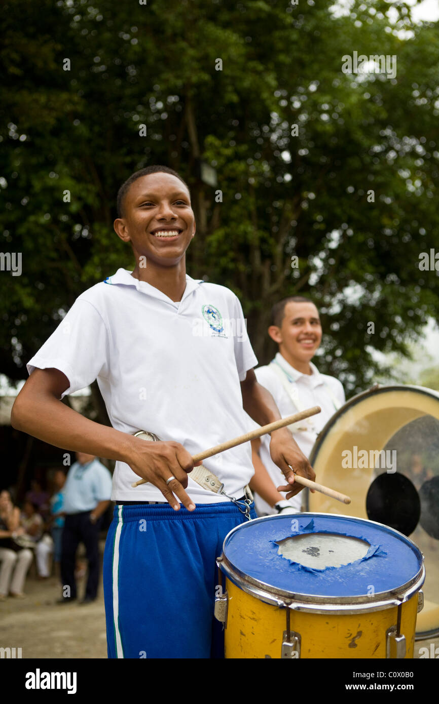 Children from Colombia playing musical instruments. The music project has been funded by Fairtrade banana exports - Stock Image