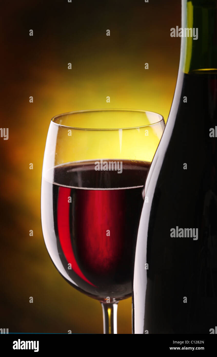 Still life with glass and bottle of wine. - Stock Image
