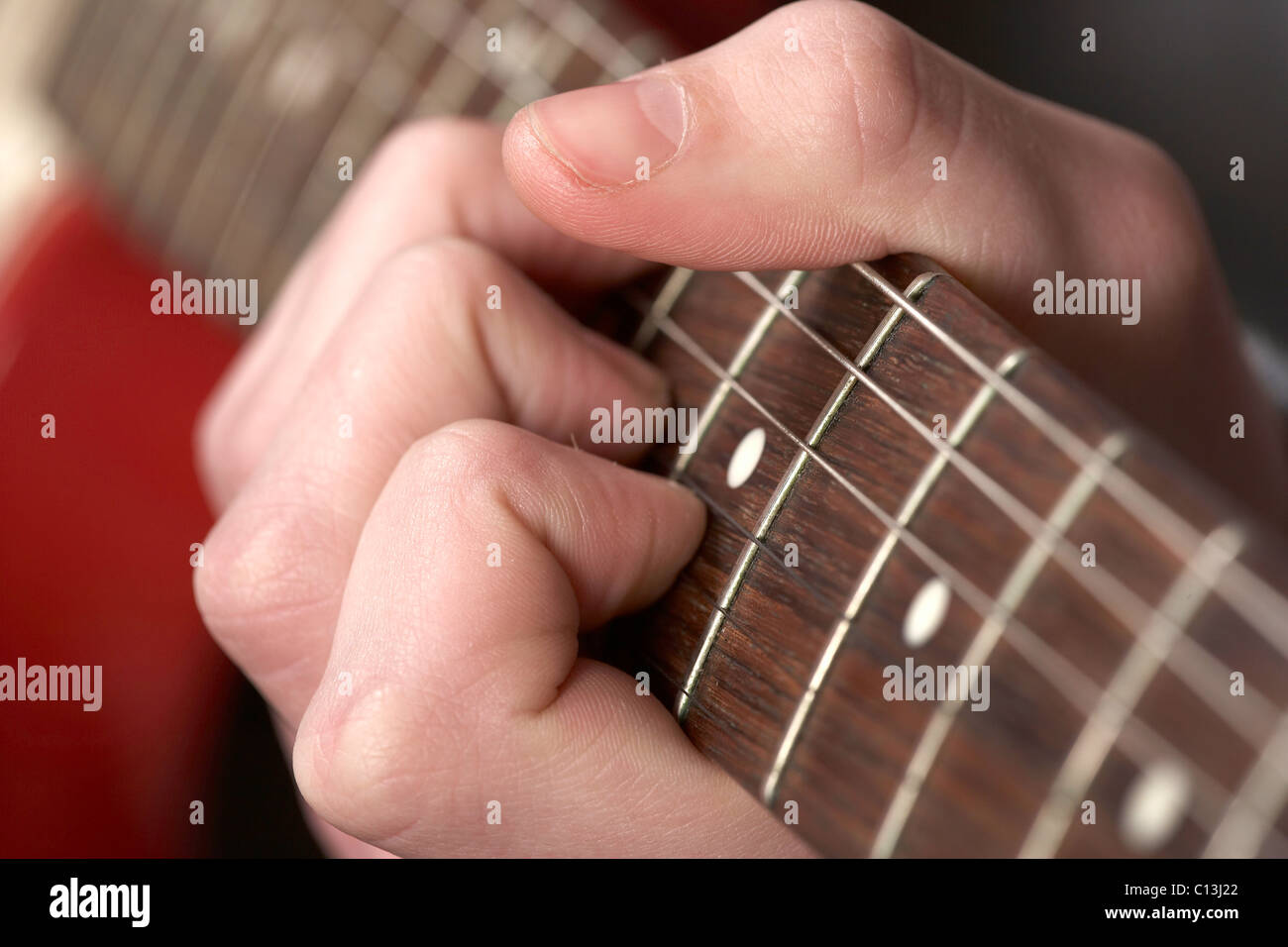 Playing Electric Guitar Looking Down The Neck With Hand Holding A