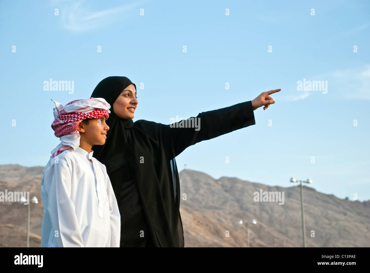 Arab Family outdoor - Stock Image