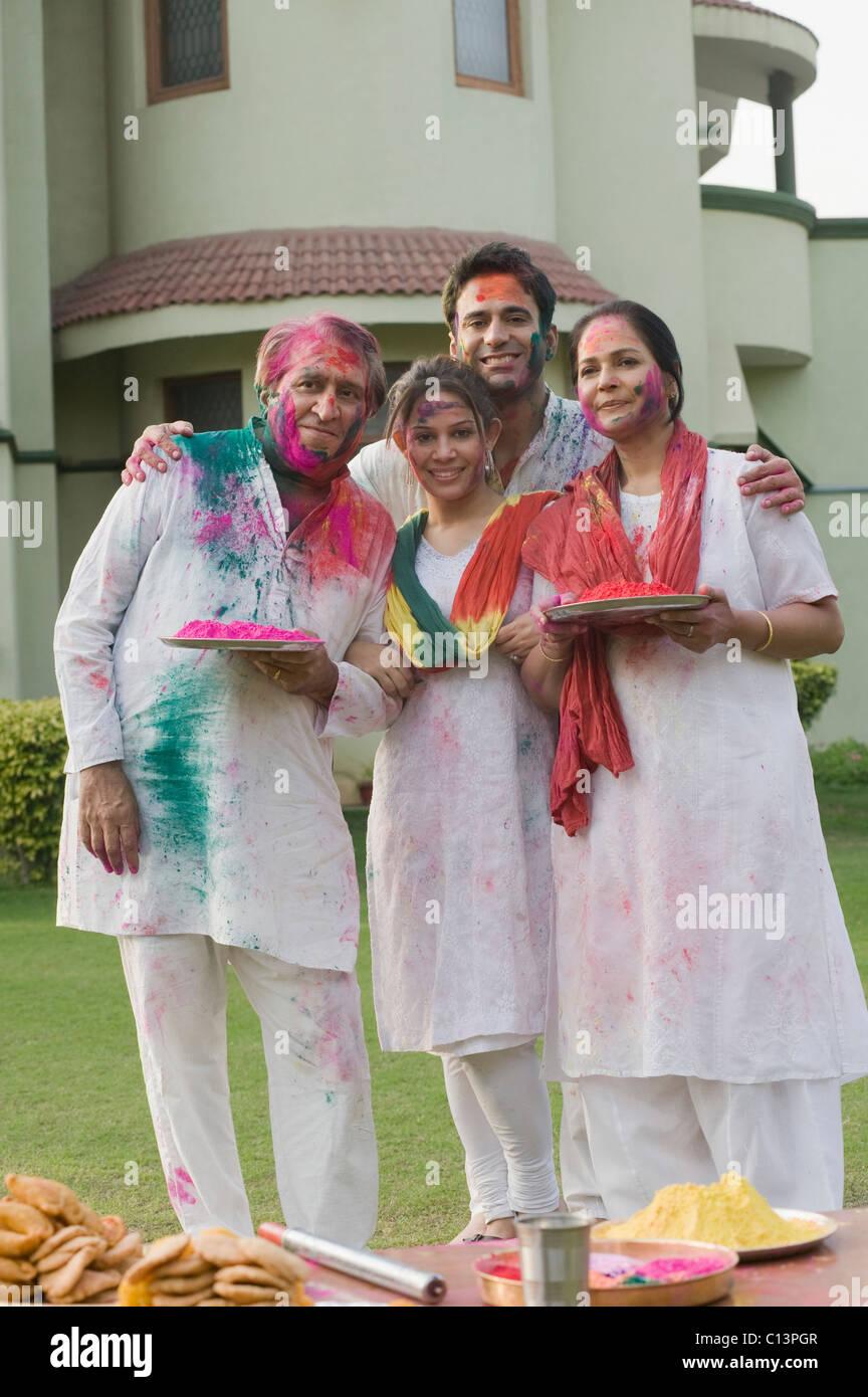 Family celebrating Holi - Stock Image