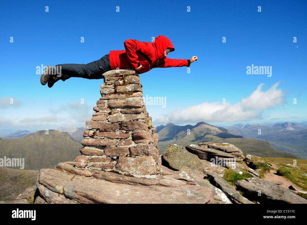 a-hillwalker-flying-like-superman-balanced-on-a-cairn-on-beinn-alligin-C1511C.jpg