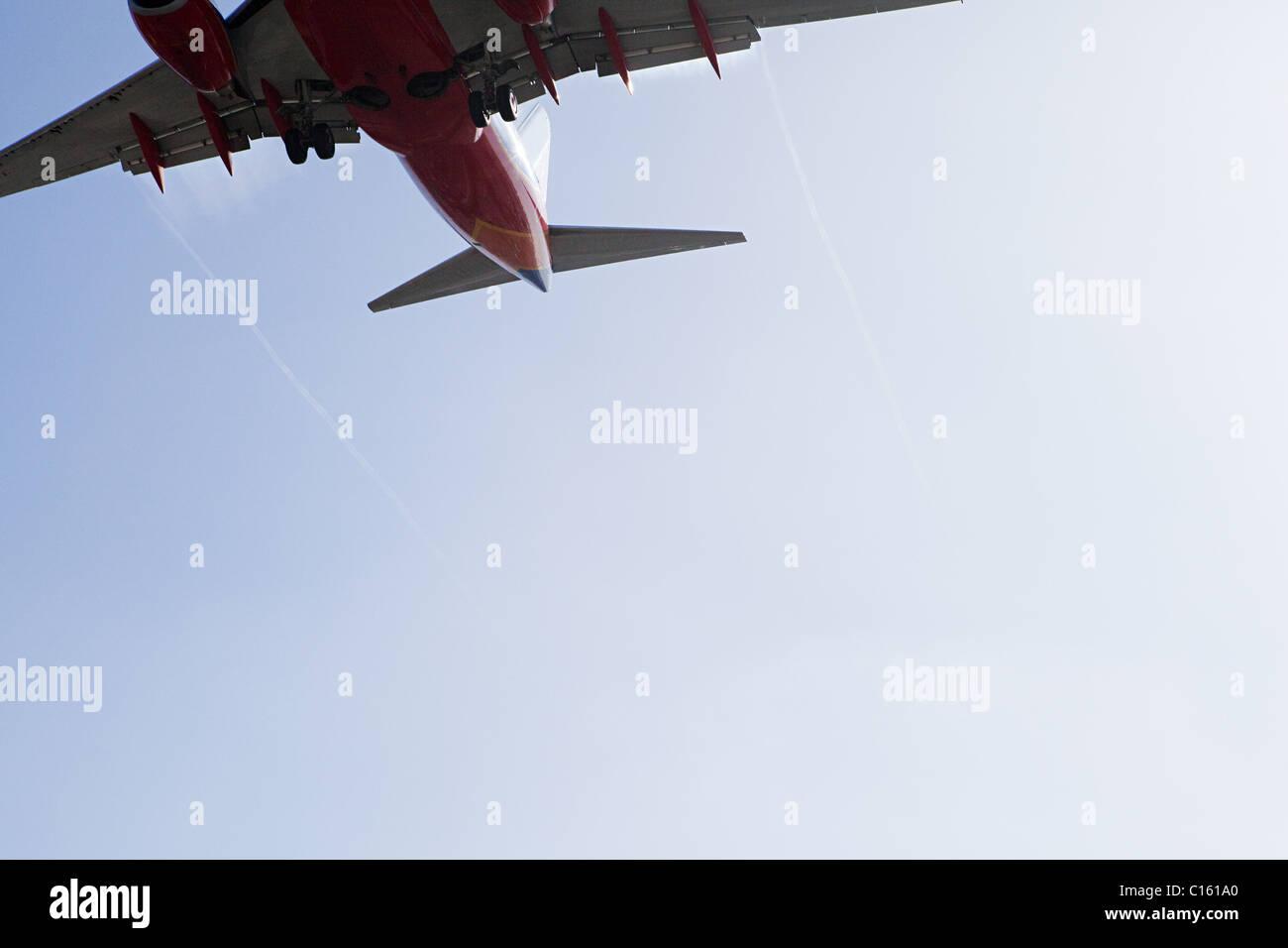 Plane landing at LAX, shot from Sepulveda, Los Angeles County, California, USA - Stock Image