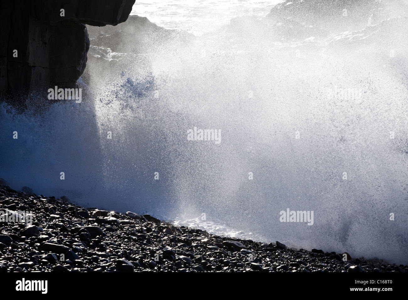 Heavy Atlantic seas with large waves crashing onto rocks at Ajuy on the Canary Island of Fuerteventura - Stock Image