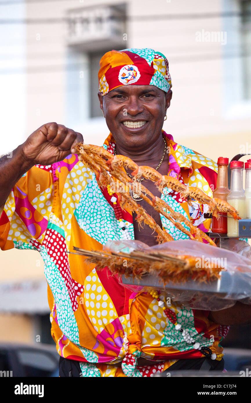 Shrimp skewers vendor on Barra Beach, Salvador, Brazil - Stock Image