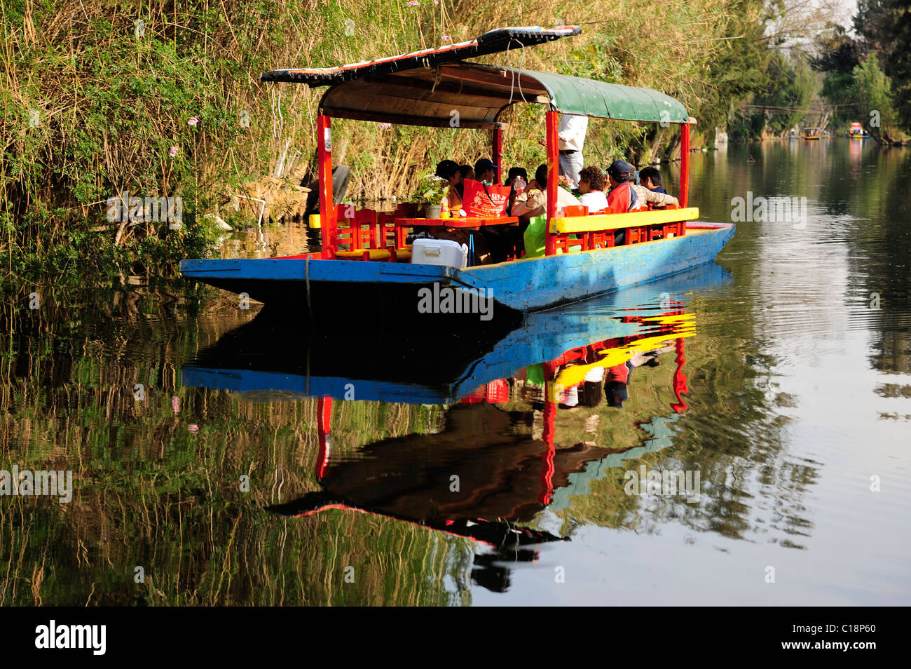 Colourful boat on canal in Xochimilco, Mexico City, Mexico - Stock Image