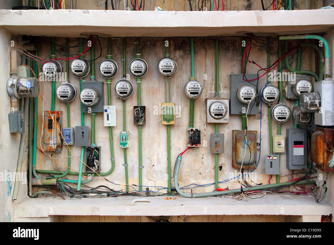dangerous electric meter messy faulty electrical wiring installation - Stock Image