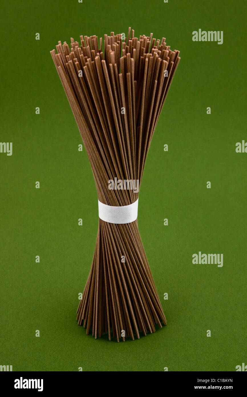 One Bundle of  Organic  Noodles on Green Background - Stock Image