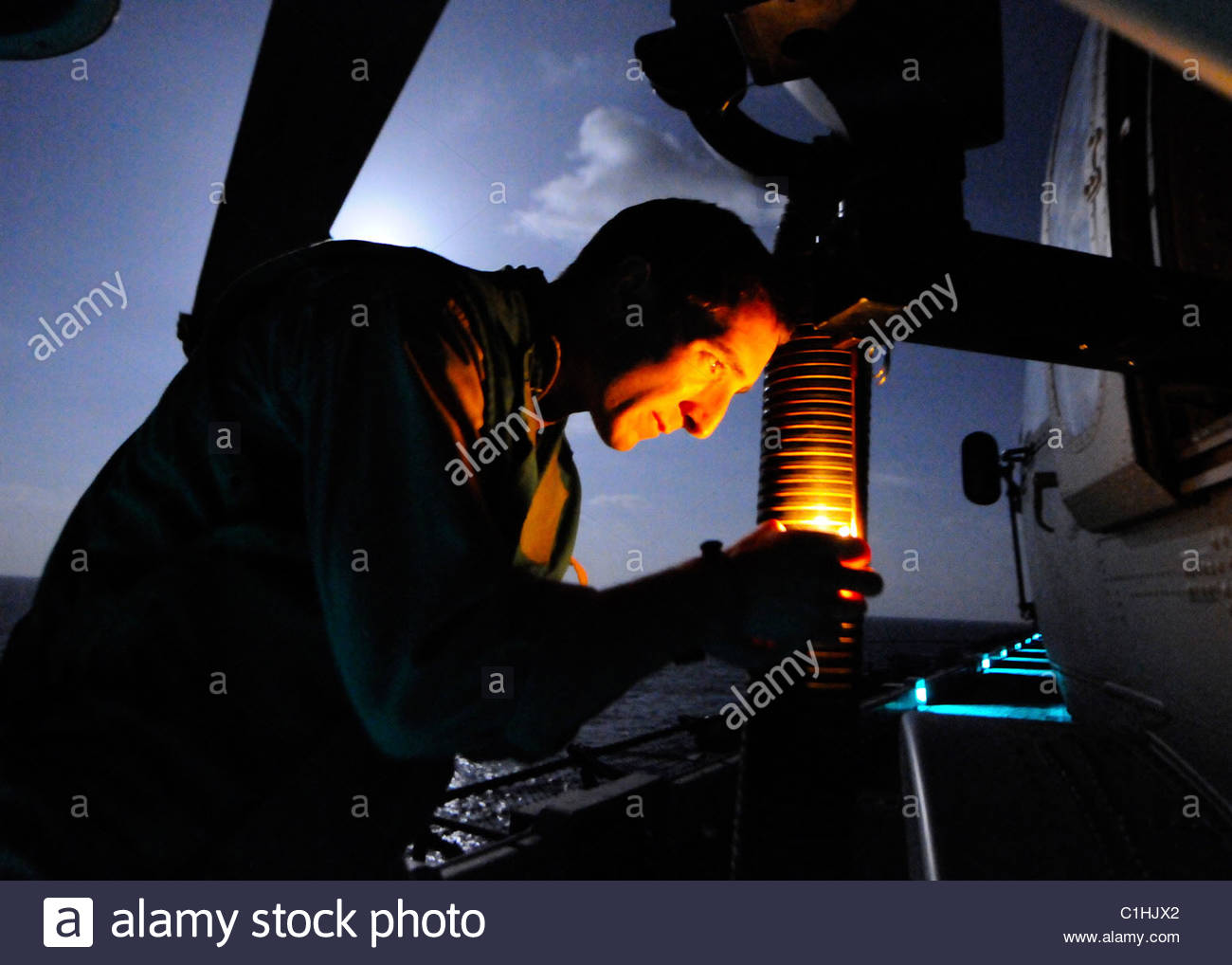 2011 March - US NAVY - Libya - GAL-21 machine gun on an MH-60S Sea Hawk helicopter on the flight deck of amphibious - Stock Image