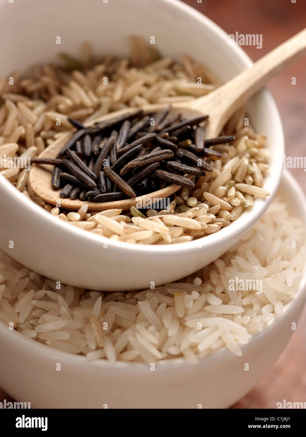 Wild rice brown rice and Basmati in measuring cups - Stock Image
