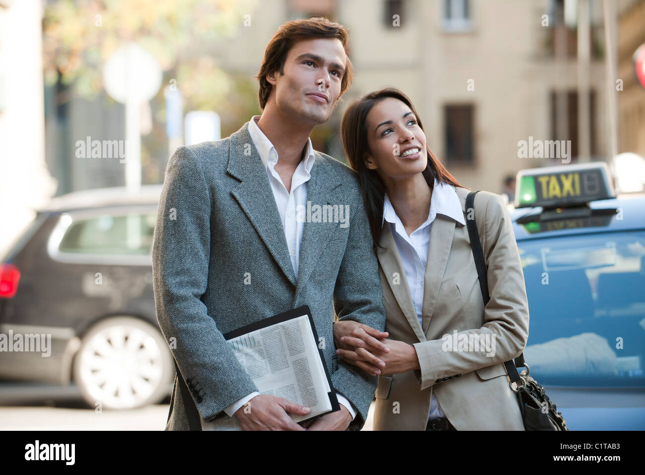 Couple arm in arm outdoors - Stock Image