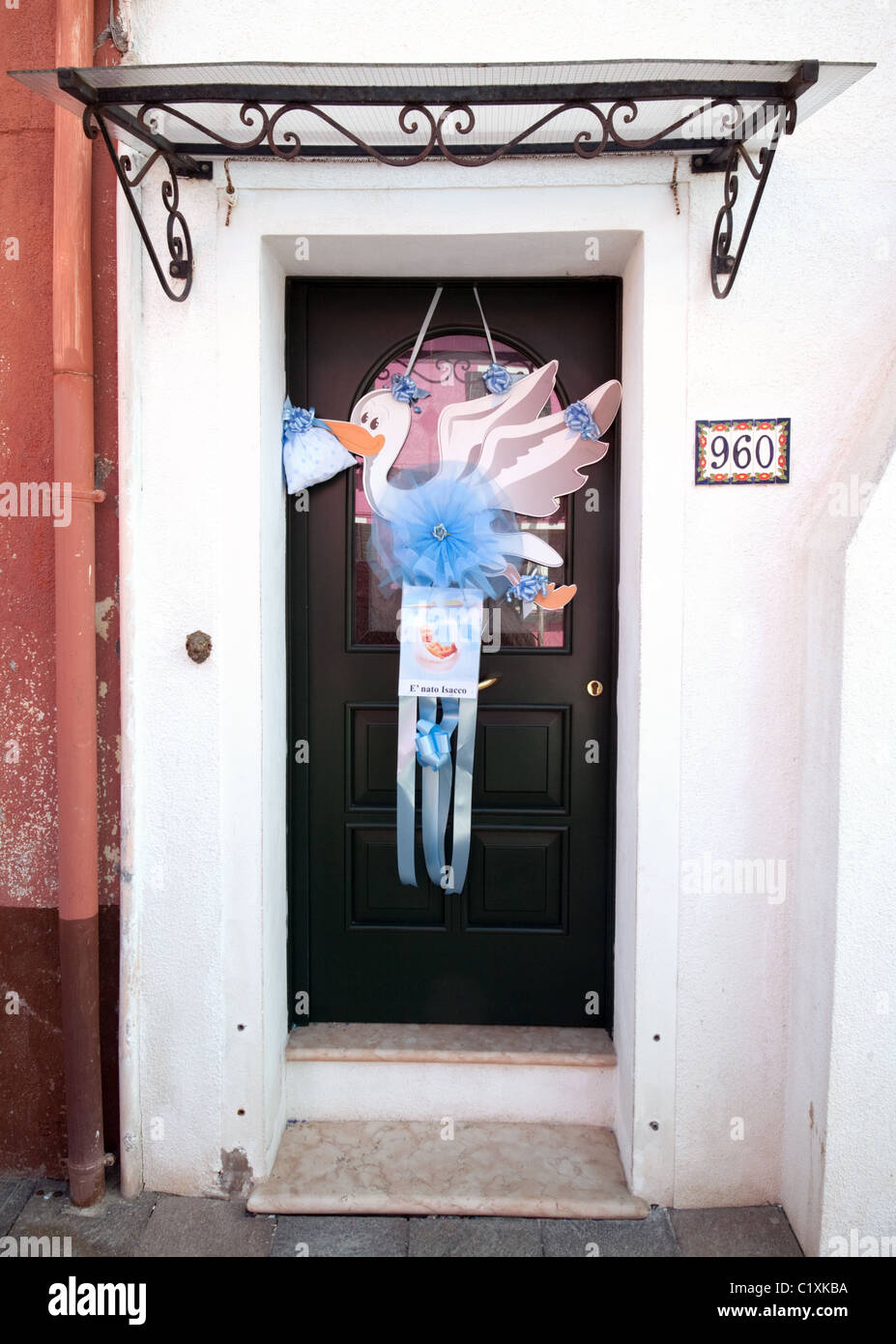 a-stork-sign-hanging-outside-a-house-door-announcing-the-birth-of-C1XKBA.jpg