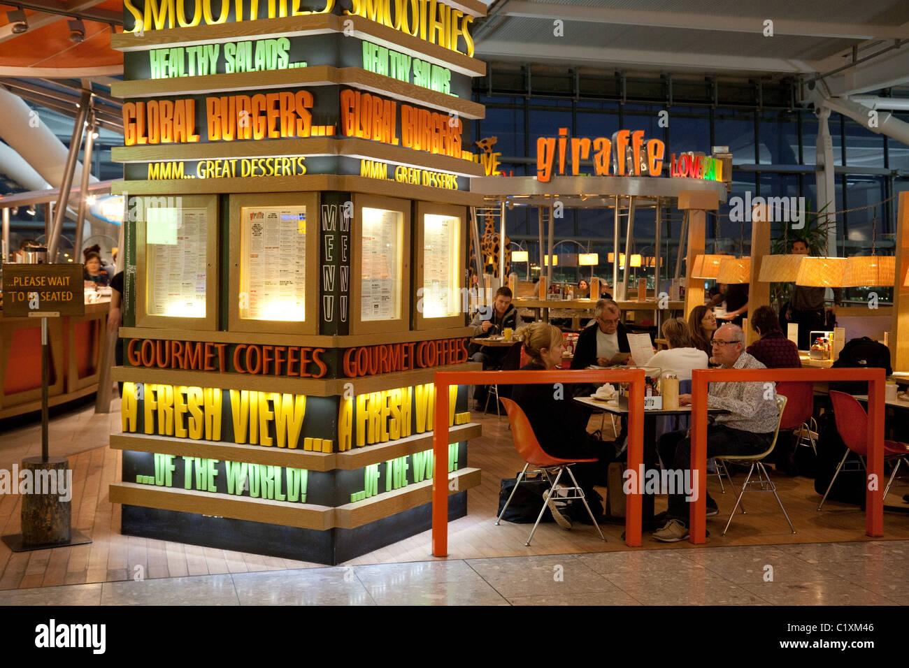 The Giraffe restaurant/cafe in terminal 5, heathrow airport London UK - Stock Image