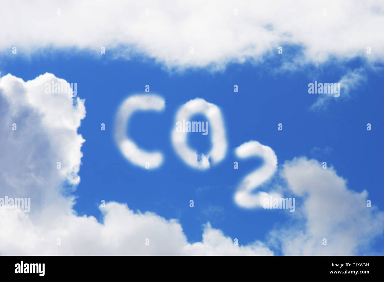 Carbon Dioxide symbol in blue sky and cloud - Stock Image