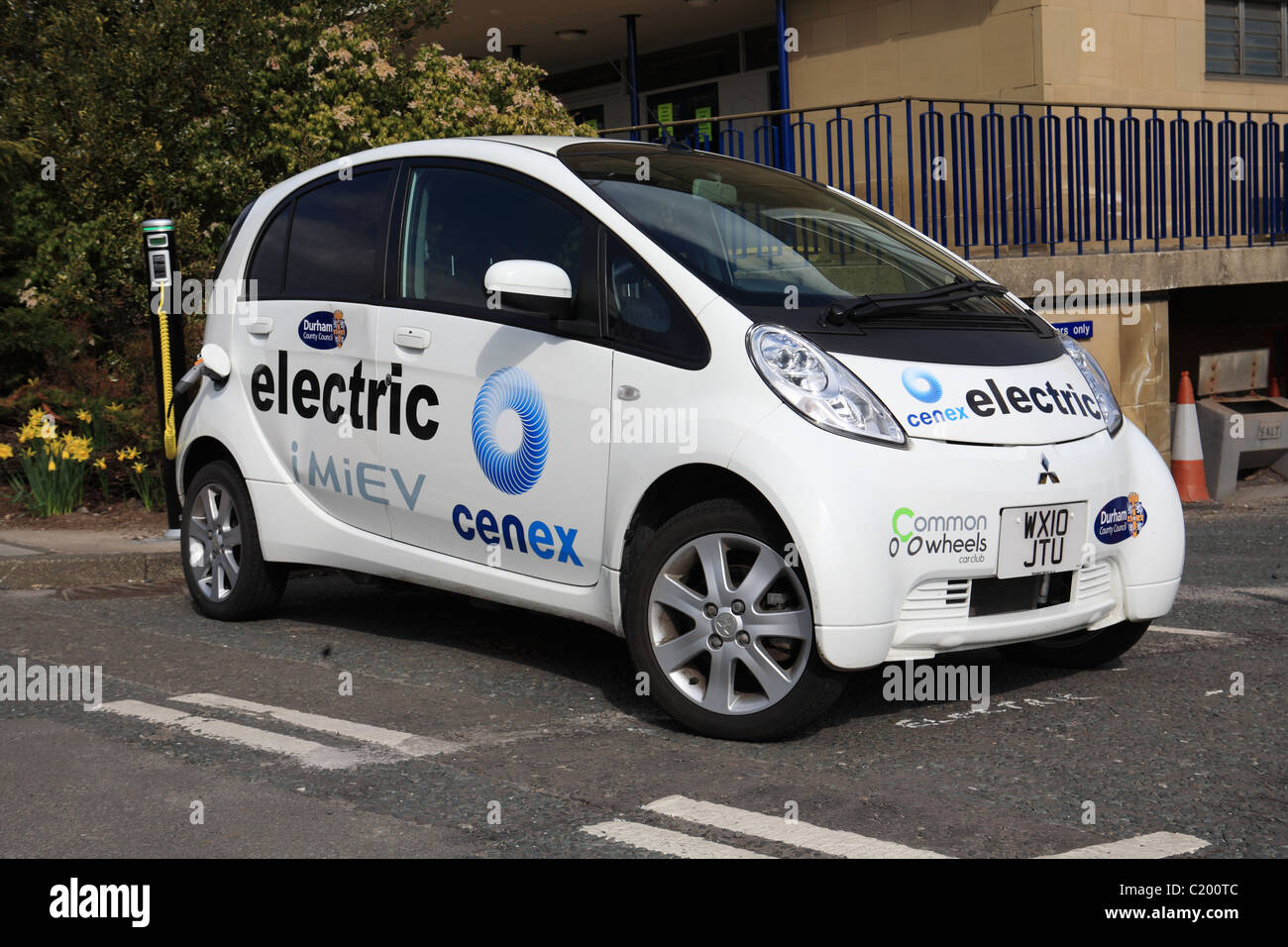 Mitsubishi iMiEV electric car at a charging point outside County Hall, Durham, NE England - Stock Image