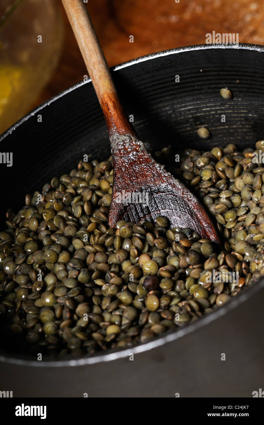 Stock photo of green lentils in a pan. - Stock Image