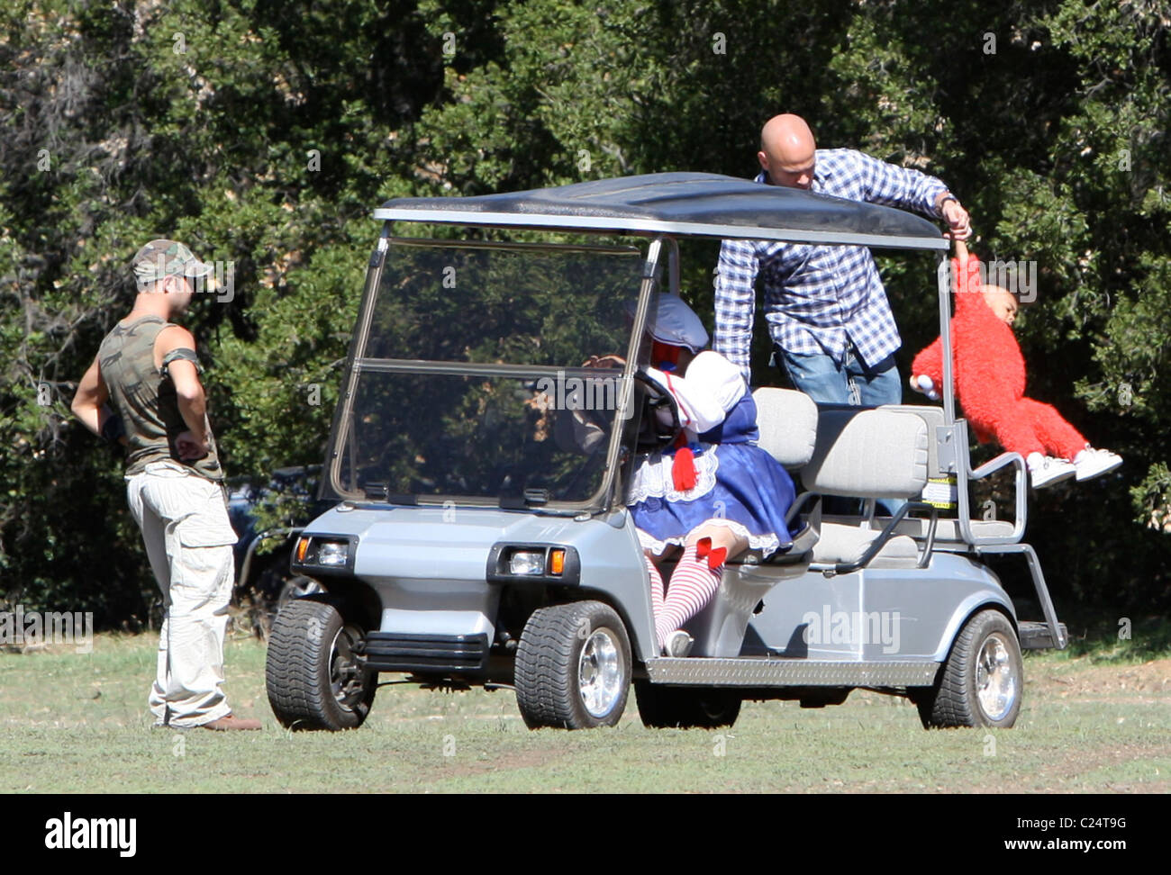 stephen belafonte and angel iris murphy on a golf cart at the 2009 bony pony ranch halloween carnival hosted by drfrank ryan