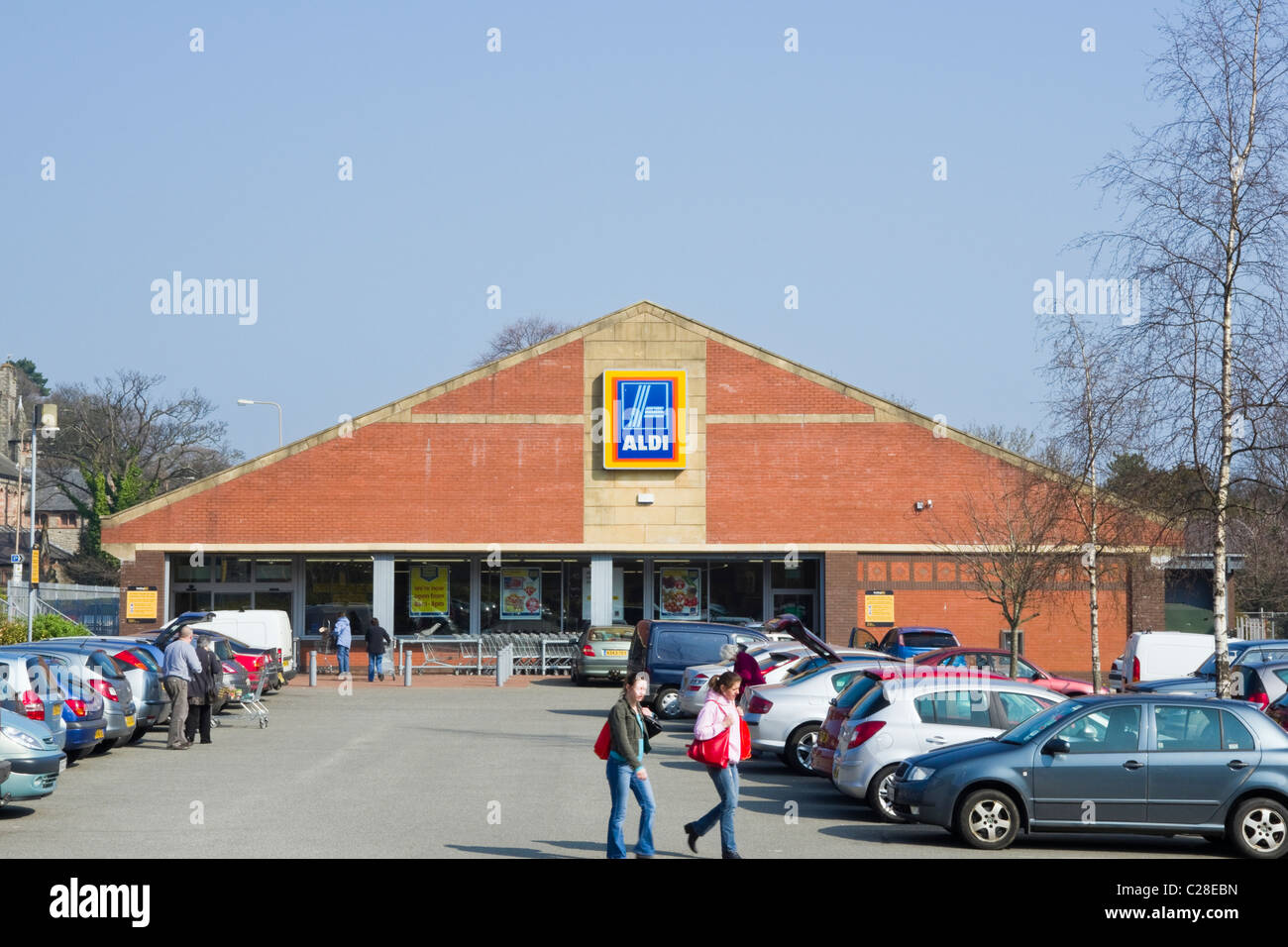 Aldi Store Front With Cars Parked In Car Park Outside Supermarket Selling  At Cheap Prices.