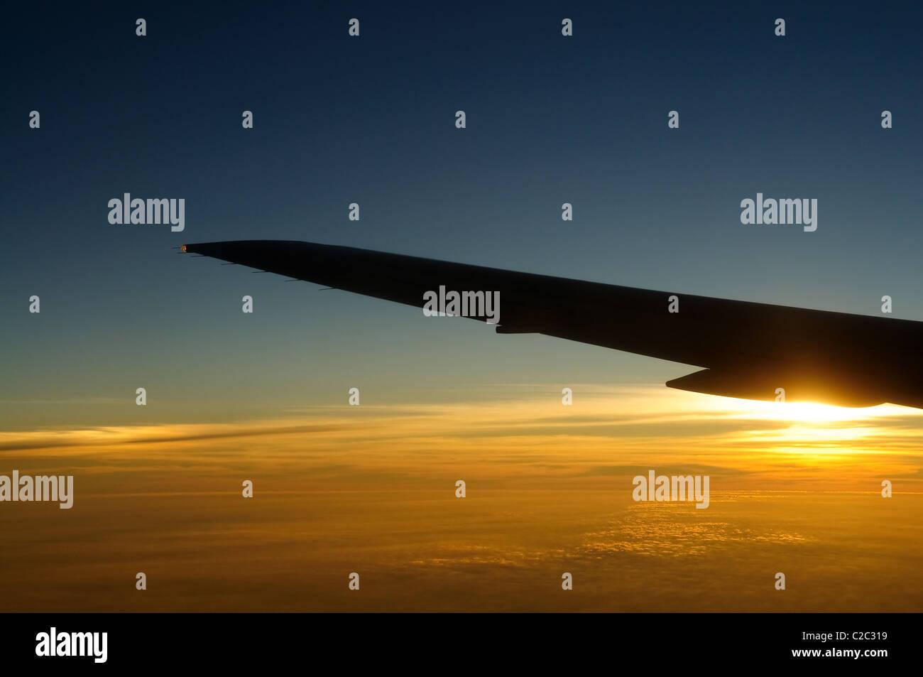 Sunset under airplane wing skyline - Stock Image