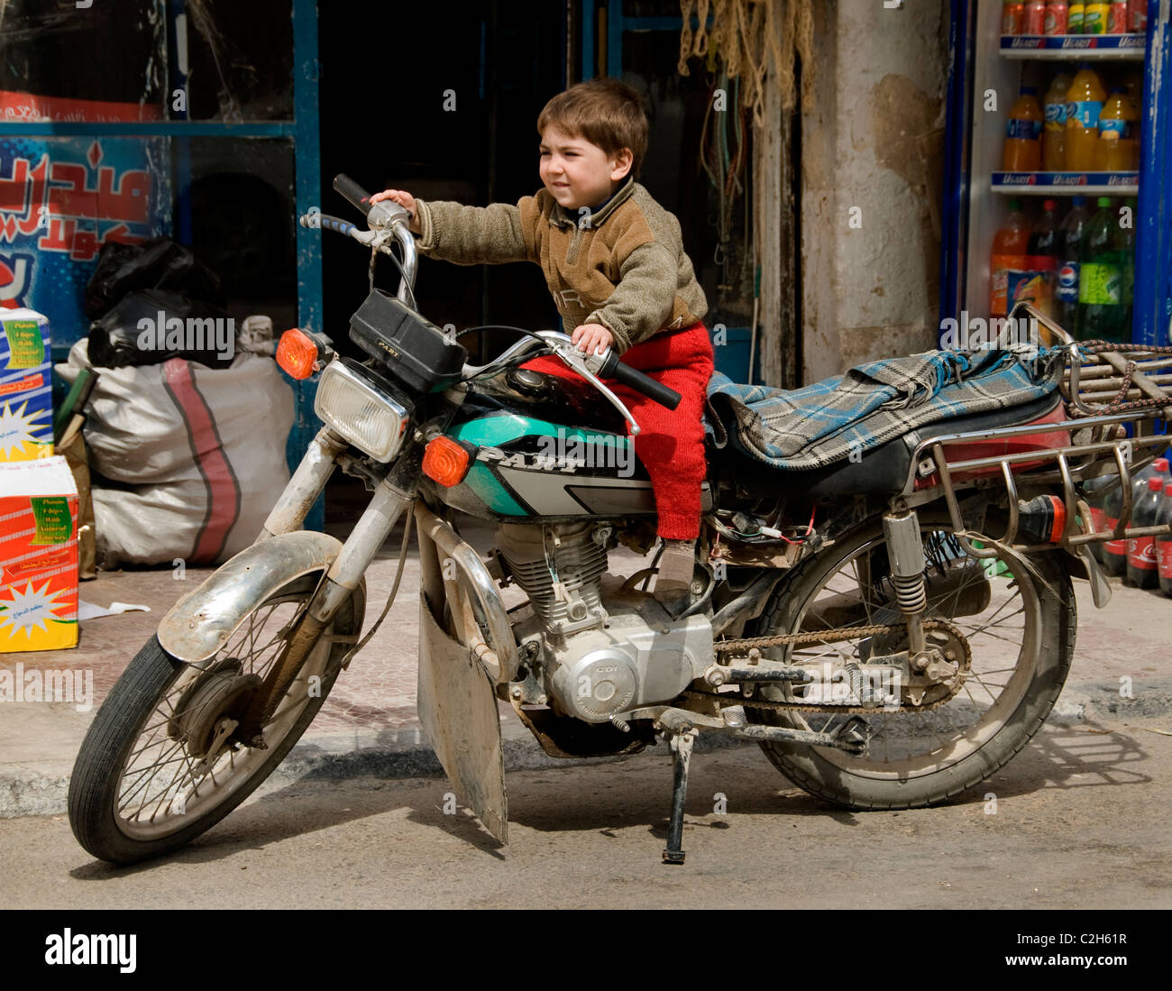 Palmyra new town city Syria Syrian motorcycle young boy motorbike Stock Photo