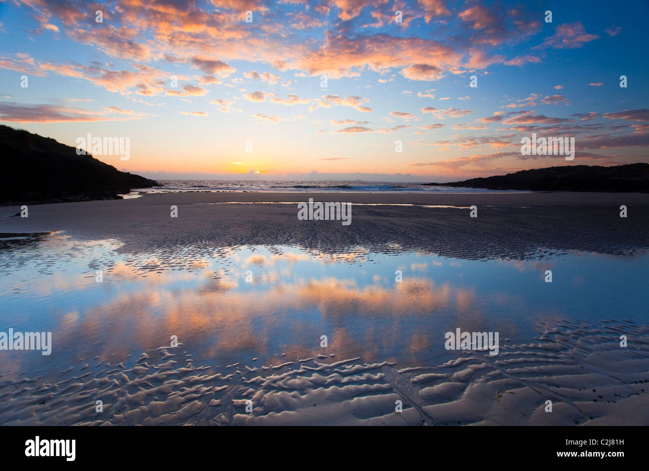 Evening beach reflections, False Bay, Connemara, Co Galway, Ireland. - Stock Image