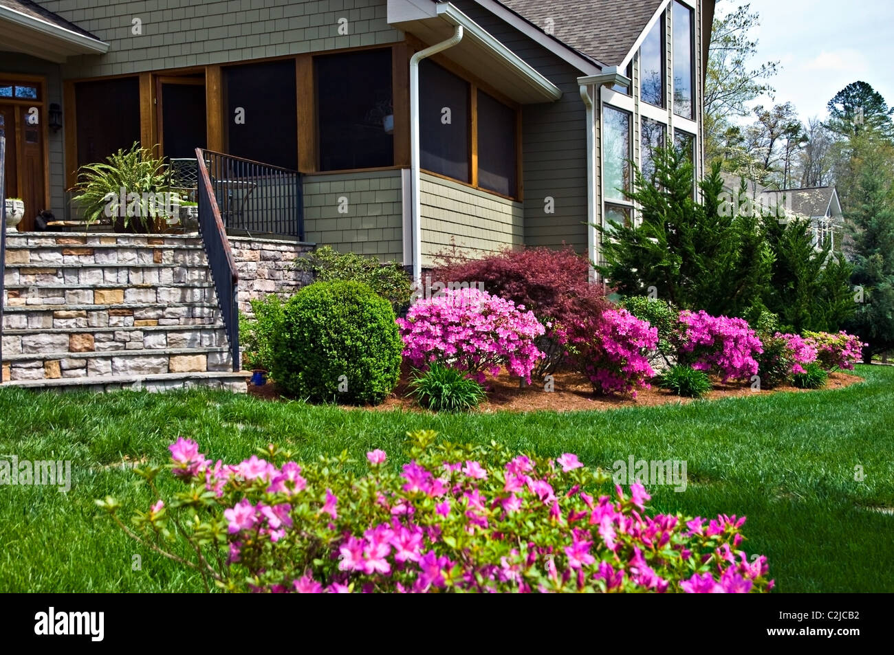 Front Porch Area Of A House Showing The Blooming Azaleas In The