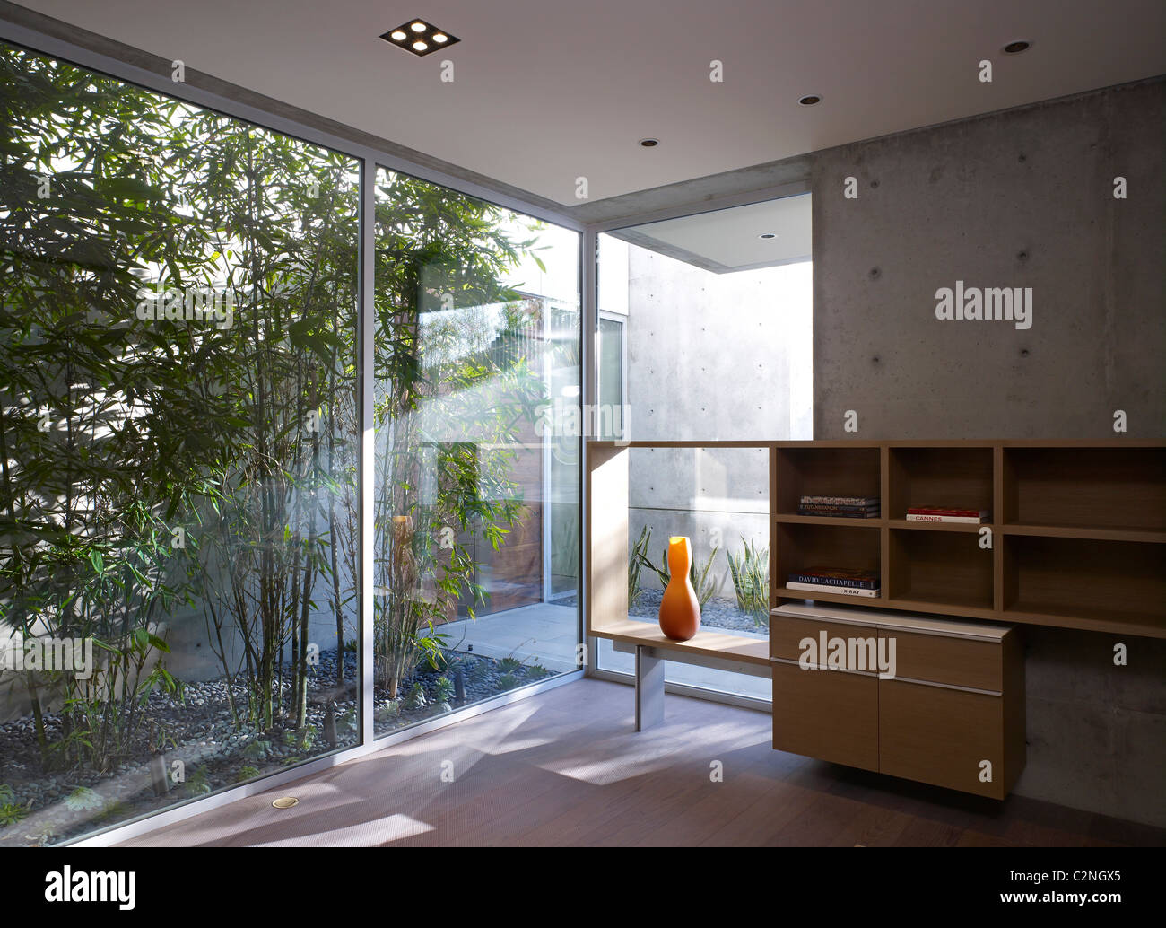 Modern detached house, West Hollywood, California. Interior corner detail with full-height windows - Stock Image