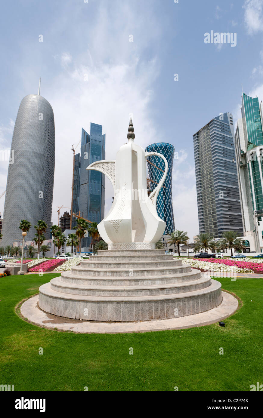 Tea pot monument and  skyline of office towers in business district of Doha in Qatar, Middle East - Stock Image