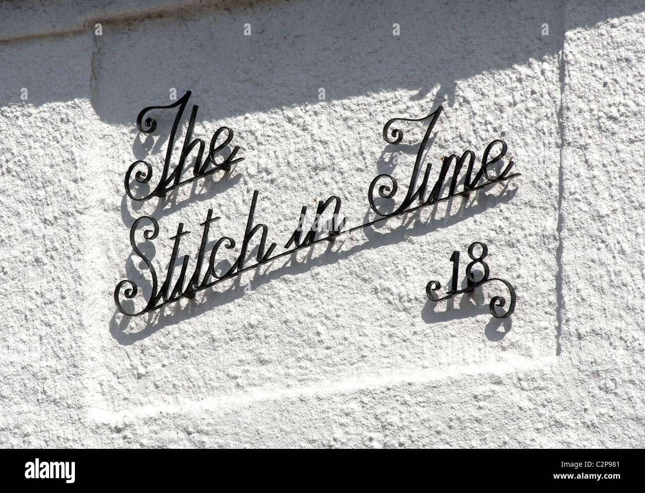 'The Stitch in Time' name on a house - Stock Image