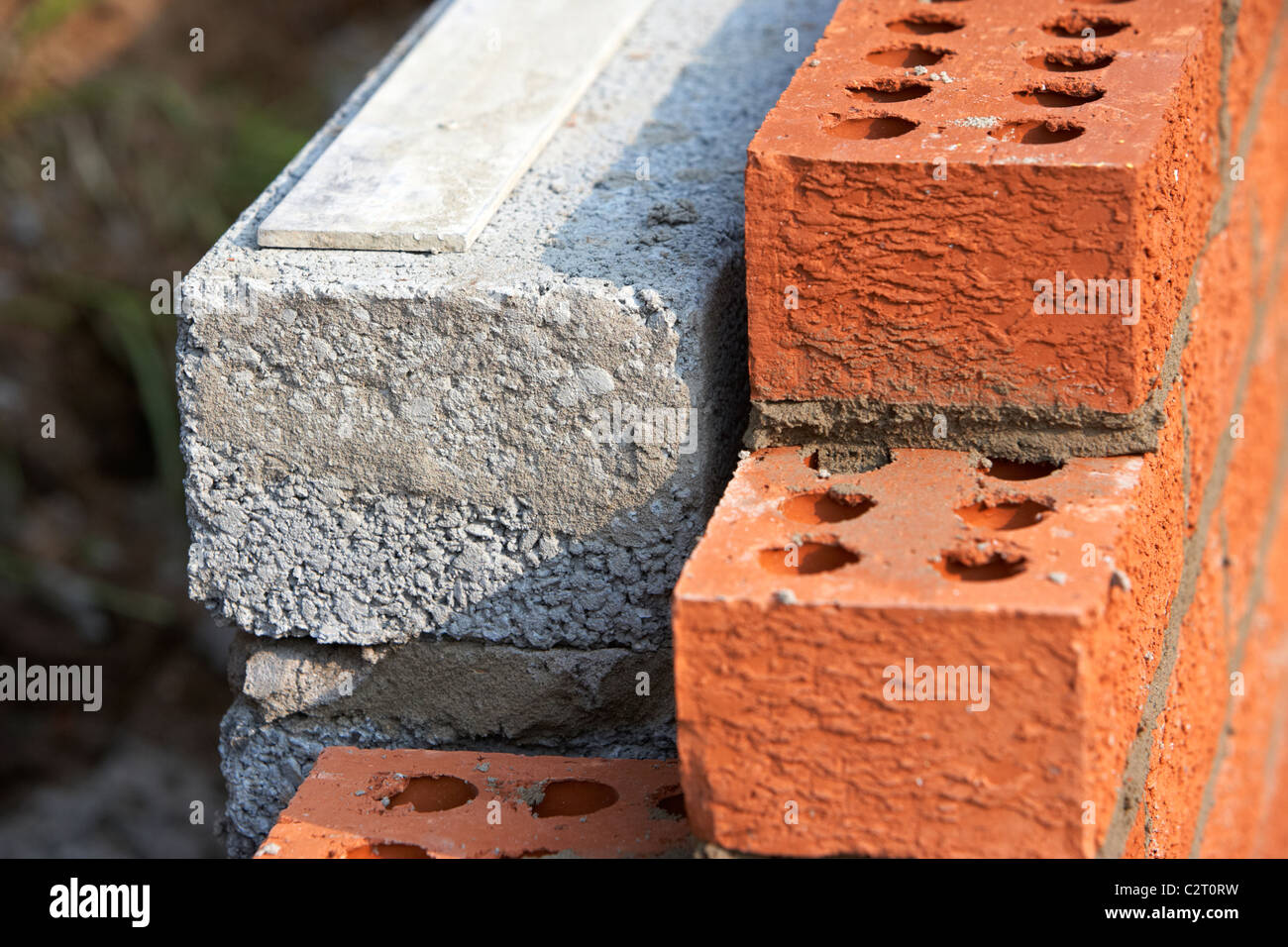 Nice Bricklaying Wall Red House Bricks Facing Half Cement Breeze Blocks Building  A Block Retaining Wall In The Uk