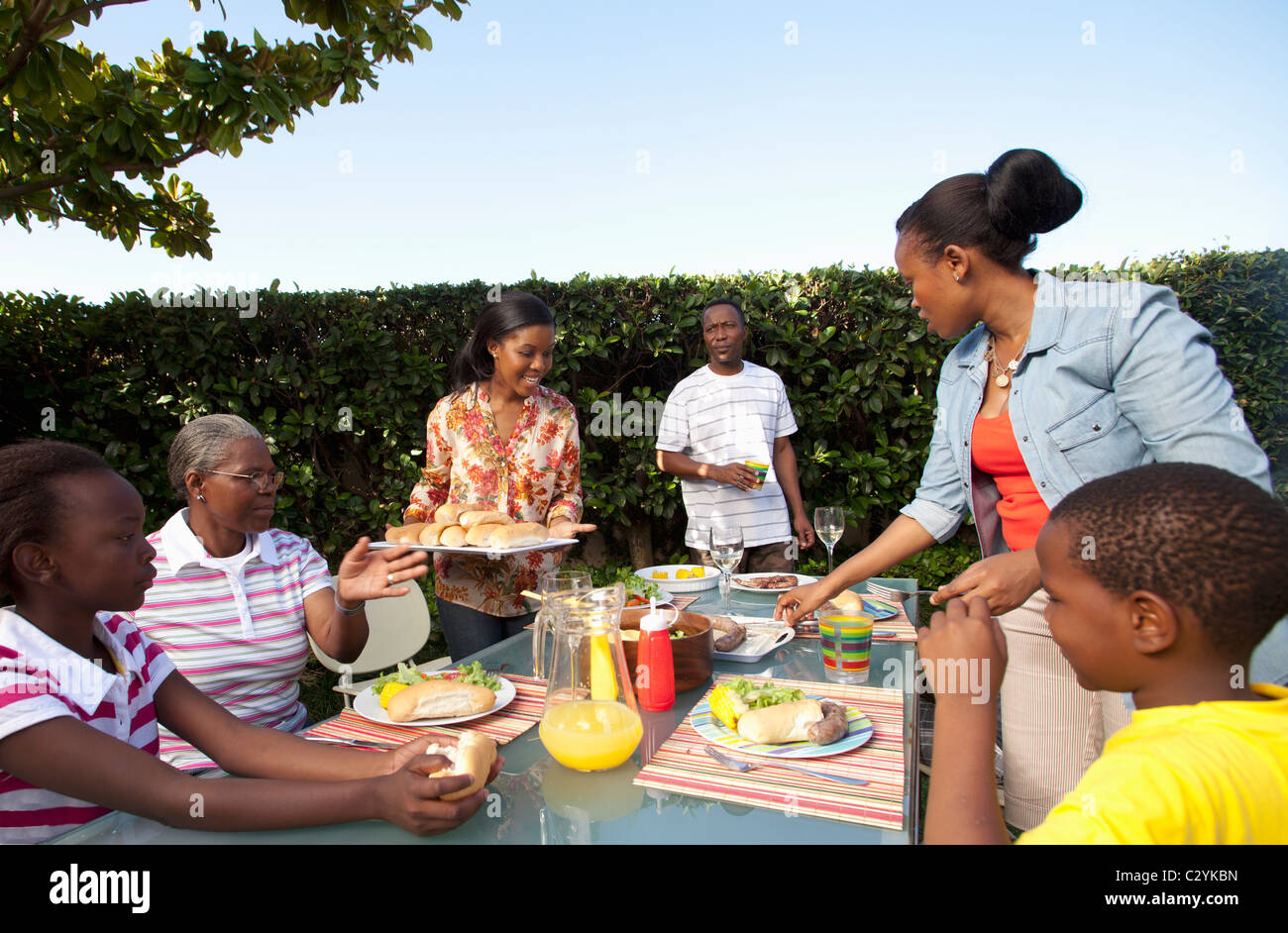 Family having lunch outside, Johannesburg, South Africa - Stock Image