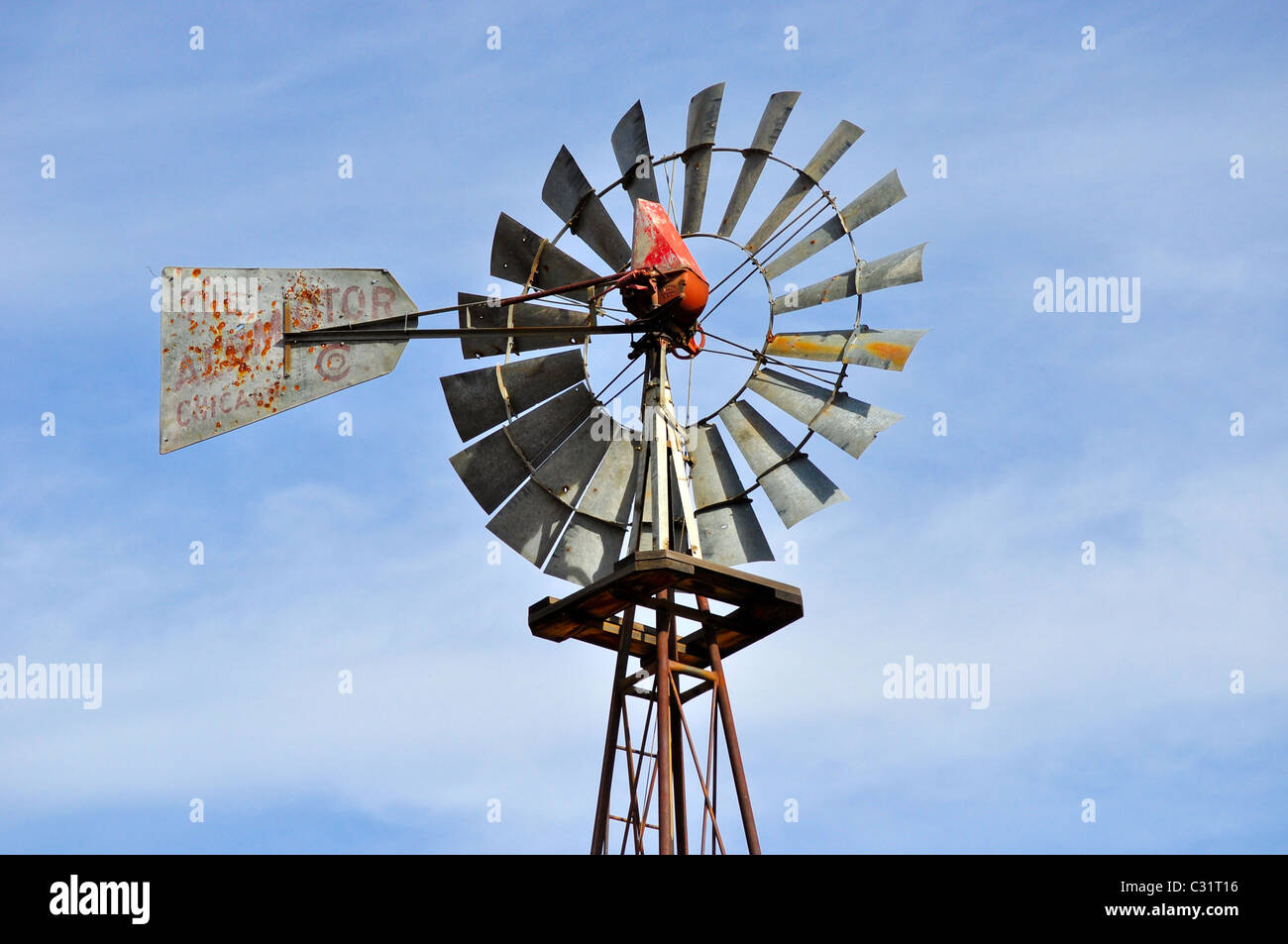 wind mill on farm in Colorado - Stock Image