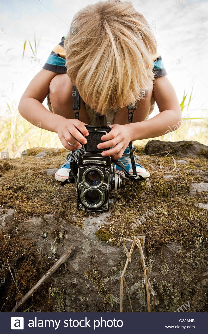 Boy using twin lens camera - Stock Image