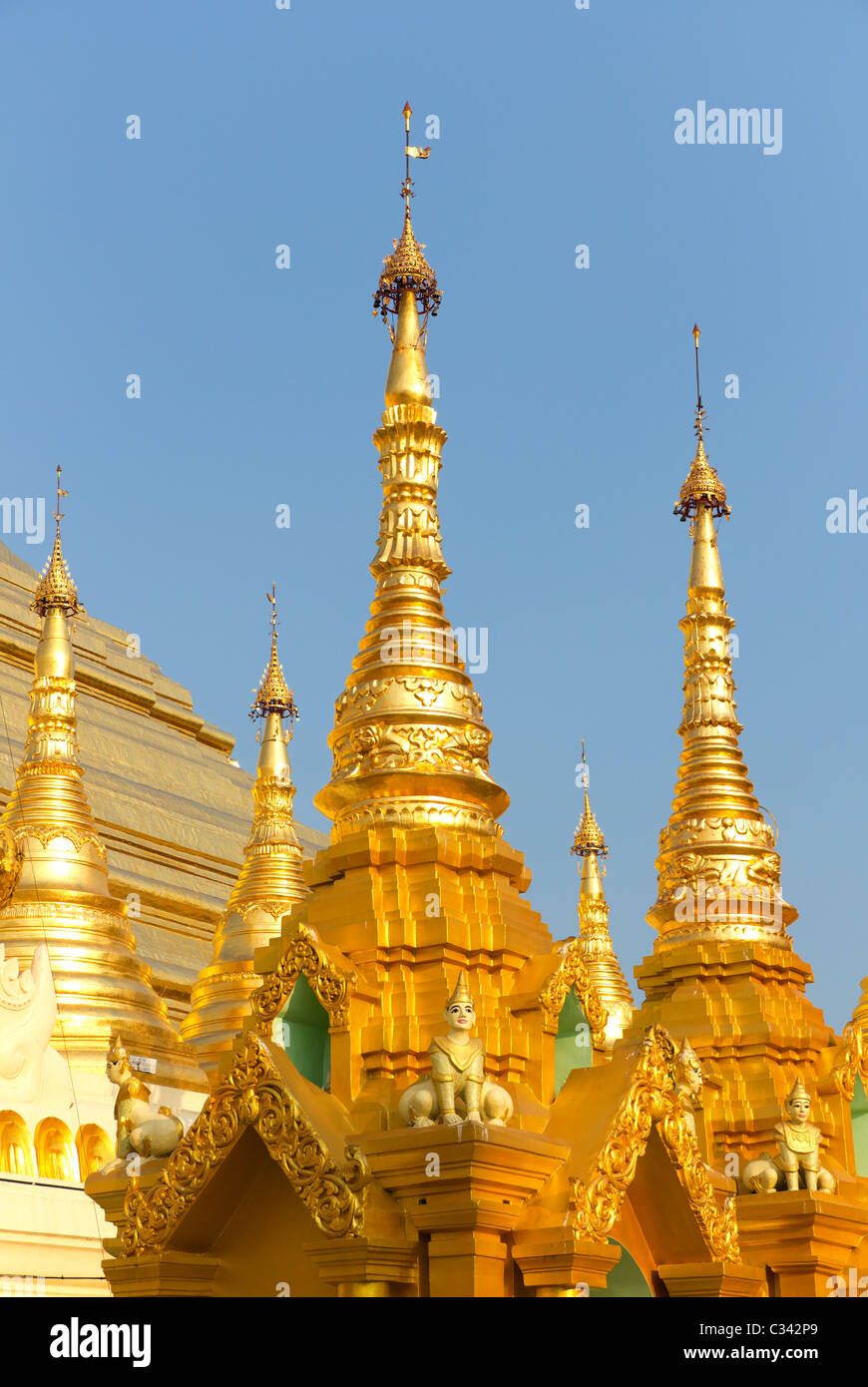 Mythical Creatures on Gold Shrines at the Buddhist Temple of the Shwedagon Paya or Pagoda in Yangon, Myanmar, Formerly - Stock Image