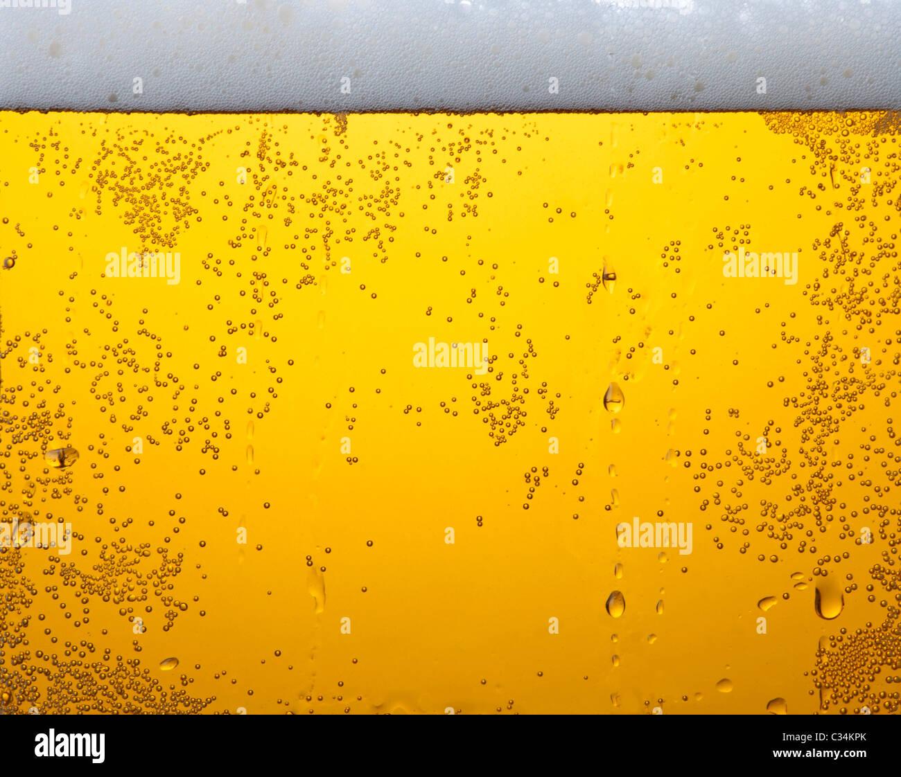 Light beer in glass texture - Stock Image