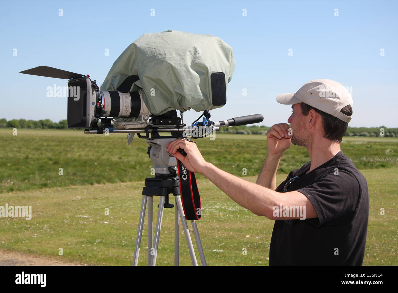 Canon 7d dslr being used as a video camera - Stock Image