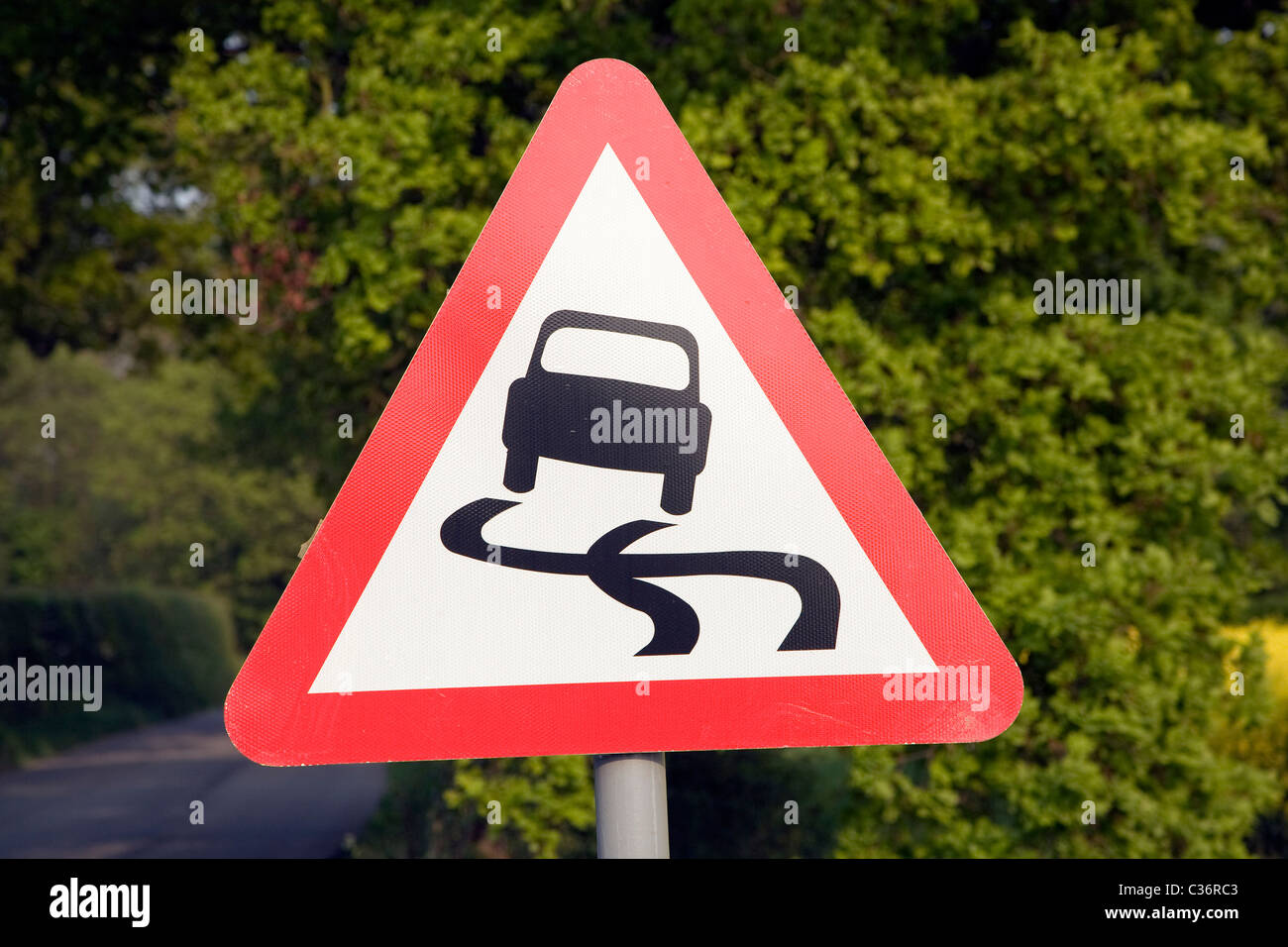Red Triangle Road Sign For Risk Of Skidding Stock Photo 36414787