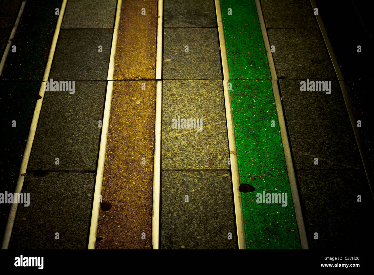 Coloured line pattern on the pavement. Abstract. - Stock Image