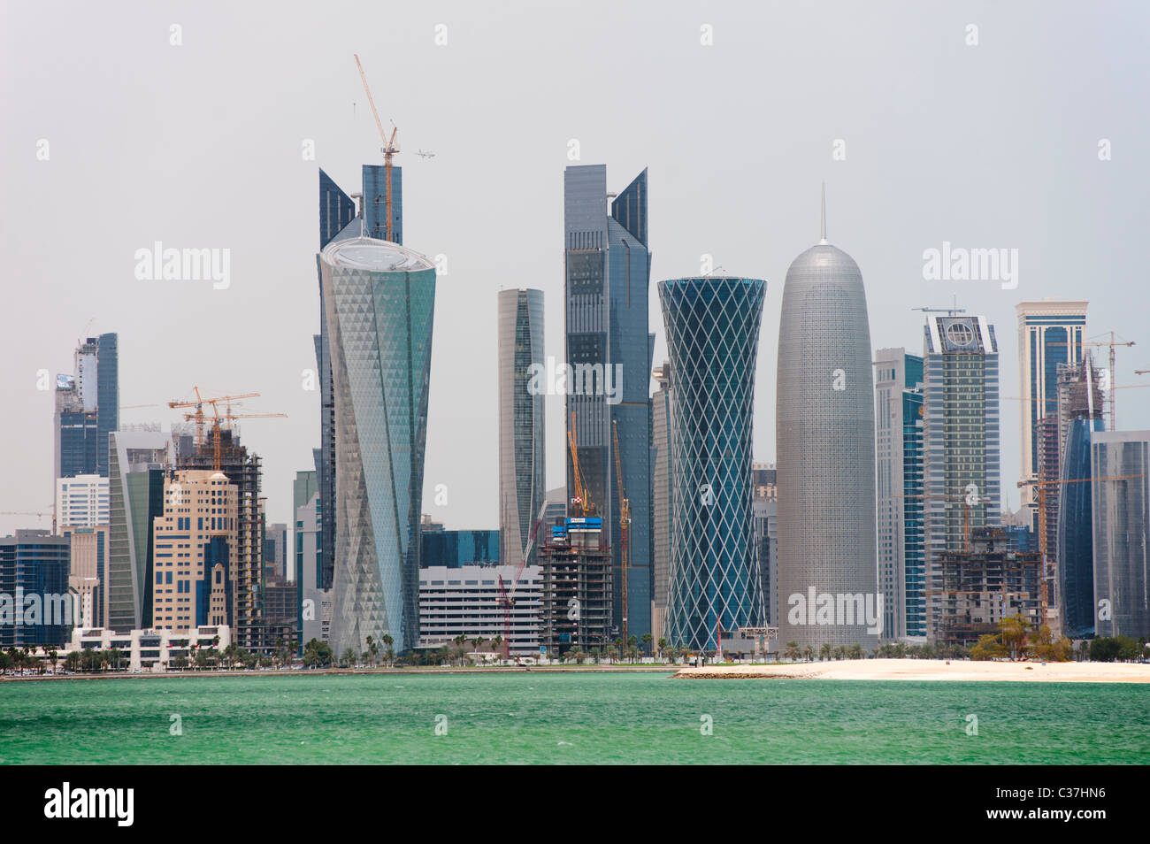 Modern high rise office towers form skyline of Doha in Qatar - Stock Image