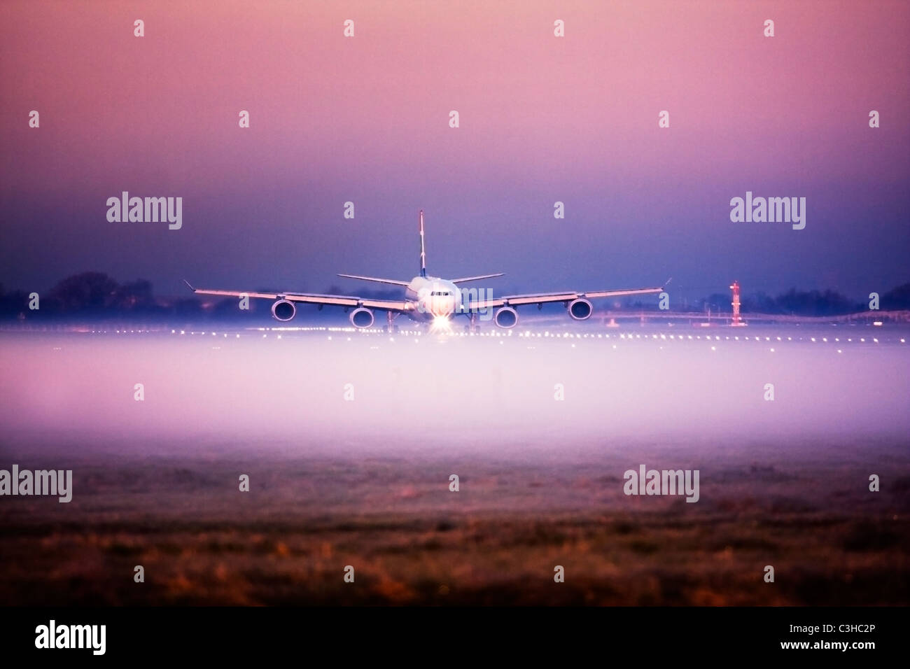 Airplane in the fog at London Heathrow Airport, UK Stock Photo